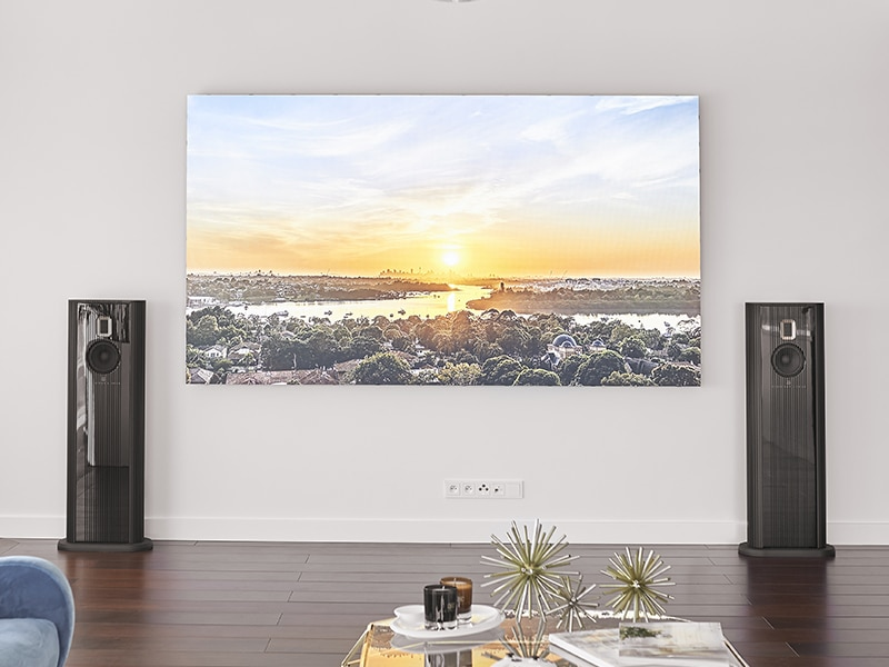 Model O speakers and Samsung screen on white wall