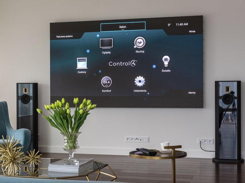 Model O speakers in Polish showroom with Samsung screen