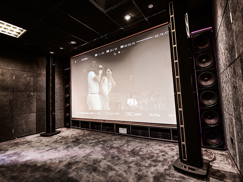 Steinway home cinema with LS Studio speakers and in-wall woofers