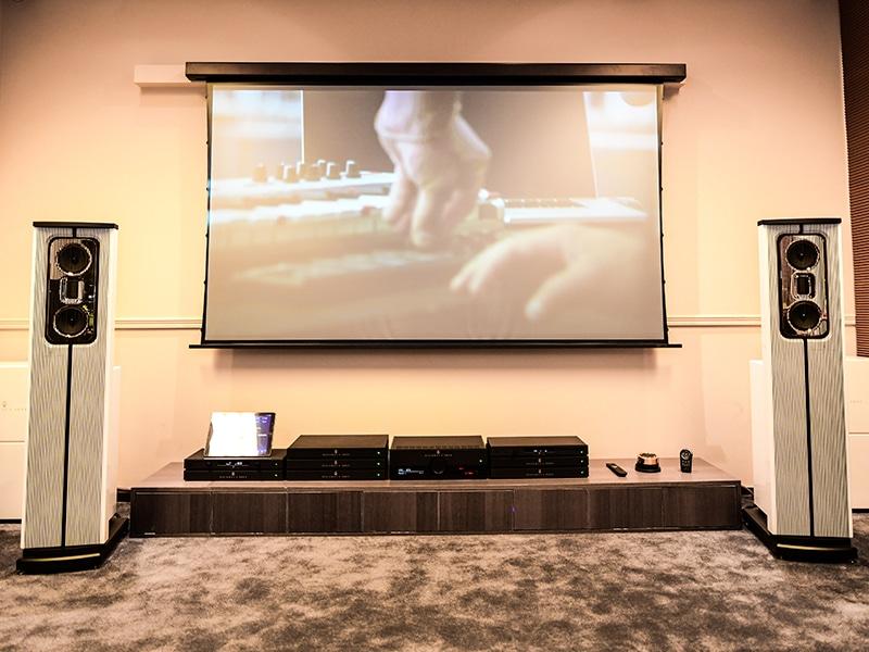 White Model C speaker system at Home Integration showroom